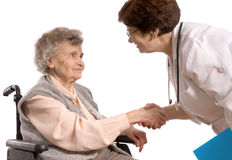Health care. Worker and elderly woman in wheelchair Royalty Free Stock Images