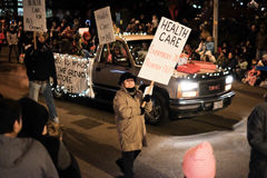 Health care advocates march in Oregon holiday parade Royalty Free Stock Photo