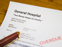 Health Care Bill. Billing statement from Hospital warns that payment is overdue. Includes sarcastic logo Your Money Keeps Us Healthy Stock Image