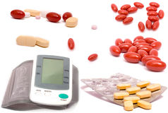 Health care composite. Full-size composite photo of various  pills and blood pressure meter with realistic drop shadows for depth on white background Stock Photo