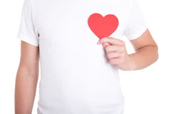 Health care concept - man holding red paper heart on white Stock Photography