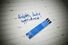 Health care concept. Stripes for glucose test and reminding note in personal organiser. Concept concerning diabetes. Stripes for glucose test, reminding note in Royalty Free Stock Image