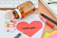 Health Care Concept - Supplement with i love you note Royalty Free Stock Images