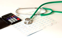 Health care costs. Stethoscope and calculator Stock Photos