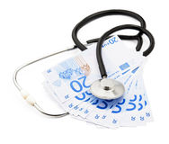 Health care costs. Stethoscope and money symbol for health care costs or medical insurance Royalty Free Stock Photography
