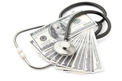 Health care costs. Stethoscope and money symbol for health care costs or medical insurance Royalty Free Stock Images