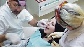 6 June, 2014, Donetsk, Ukraine, Elements Dental. Health care in dental clinic, people working as dentist and medical stock footage