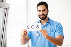 Health Care. Doctor Holding a Card With Symbol SOS, Medical Conc. Ept stock photos