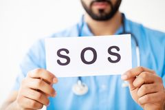 Health Care. Doctor Holding a Card With Symbol SOS, Medical Conc. Ept stock photo