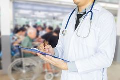 Health care, emergency room physician Writing a patient illness report. In hospital royalty free stock images