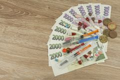 Health care financing. The concept of paying medical acts. Valid Czech banknotes and coins. Royalty Free Stock Images
