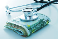 Health care industry or health care costs. A stethoscope on a wad of euro bills, depicting the concept of the health care industry or the health care costs Stock Photography