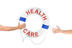 HEALTH CARE life buoy ring help reaching hands Royalty Free Stock Photos