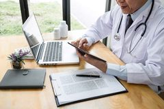 Health care and Medical concept, doctor checking patient history form while think about finding a cure for a diagnosis, treatment. Methods to rehabilitate the royalty free stock photography