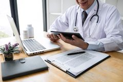 Health care and Medical concept, doctor checking patient history form while think about finding a cure for a diagnosis, treatment. Methods to rehabilitate the stock image