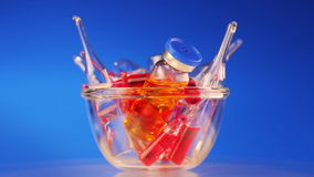 Health care / medical concept: many vivid ampoules rotating stock video footage
