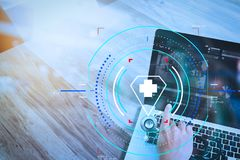 Medical technology concept. Doctor hand working with stethoscope. Health care and medical services with circular AR diagram.Medical technology concept. Doctor stock images