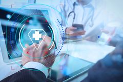 Medical technology network team concept. Doctor hand working wit. Health care and medical services with circular AR diagram.Medical technology network team royalty free stock image
