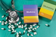 Health care medical and sickness concept. Pills and medical equipment background with a drug box fake write & x22;Medicine. Stethoscope white capsule view top royalty free stock image