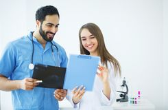 Health Care. Medical Team Examining X-ray Report in Corridor. Me. Dical Concept stock photography