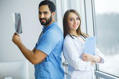 Health Care. Medical Team Examining X-ray Report in Corridor. Me. Dical Concept royalty free stock image