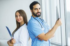 Health Care. Medical Team Examining X-ray Report in Corridor. Me. Dical Concept royalty free stock photography