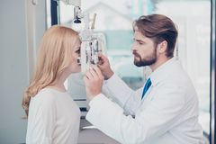 Health care, medicine, eye sight and technology concept. Side pr. Health care, medicine, eye sight and technology concept. e profile photo of brunet bearded stock photo
