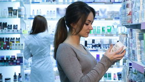 Health care and pharmacology concept. Medicine, pharmacy, people, health care and pharmacology concept. Pharmacist explaining medicine to his customer in the stock video footage