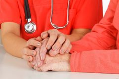 Health care. Photo of a caregiver hand touching elderly patients hand Royalty Free Stock Photography