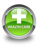 Health care (plus sign) glossy green round button Royalty Free Stock Photography