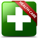 Health care plus sign green square button. Reflecting shadow with red ribbon in corner Royalty Free Stock Images