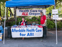Health care policy volunteers staff booth at Corvallis Farmers M Stock Images
