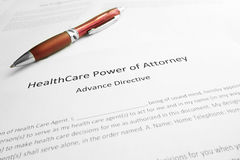 Health Care Power of Attorney. Healthcare Power of Attorney document with pen stock photography