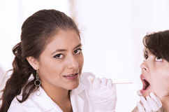 Health care professional checking patient's throat Royalty Free Stock Photo