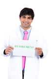 Health care professional with stethoscope and pink tie holding a sign that says retirement Stock Photography