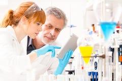 Health care professionals in lab. Stock Photos