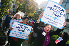 Health Care Protest. WASHINGTON, DC - OCT 22, 2009: Health-care reform advocates march in the streets outside of a meeting of America's Health Insurance Plans ( Royalty Free Stock Image