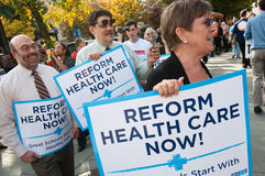 Health Care Protest. WASHINGTON, DC - OCT 22, 2009: Health-care reform advocates march in the streets outside of a meeting of America's Health Insurance Plans ( Stock Photo