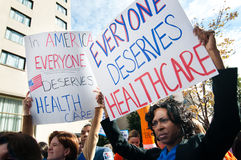 Health Care Protest. WASHINGTON, DC - OCT 22, 2009: Health-care reform advocates march in the streets outside of a meeting of America's Health Insurance Plans ( Stock Photos