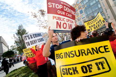 Health Care Protest. WASHINGTON, DC - OCT 22, 2009: Health-care reform advocates march in the streets outside of a meeting of America's Health Insurance Plans ( Stock Image