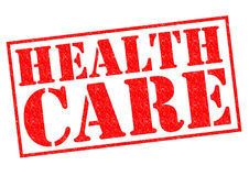 HEALTH CARE. Red Rubber Stamp over a white background Stock Photography