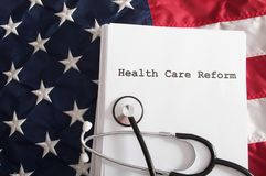 Health Care Reform USA. A health care reform document on a usa flag with nobody Royalty Free Stock Image