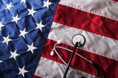Health Care Reform USA. A health care reform document on a usa flag with nobody Royalty Free Stock Photography