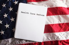 Health Care Reform USA. A health care reform document on a usa flag with nobody Royalty Free Stock Photo