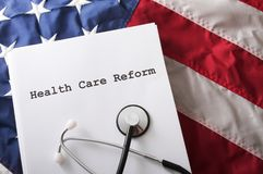 Health Care Reform USA. A health care reform document on a usa flag with nobody Stock Image
