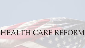 Health care reform words on USA flag Royalty Free Stock Image