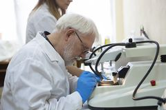 Health care researchers working in life science laboratory. stock photos