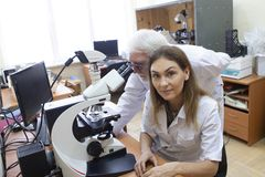 Health care researchers working in life science laboratory. royalty free stock photo