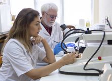 Health care researchers working in life science laboratory. stock image