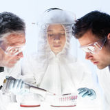 Health care researchers working in scientific laboratory. Royalty Free Stock Photography